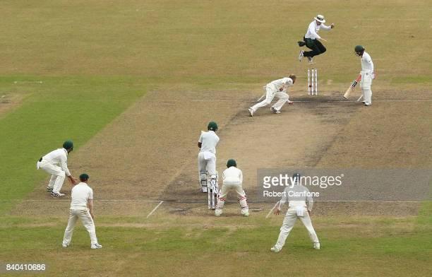 Nathan Lyon of Australia runsout Mushfiqur Rahim of Bangladesh during day three of the First Test match between Bangladesh and Australia at Shere...
