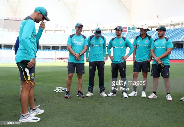Nathan Lyon of Australia shows his emotions as he presents Travis Head of Australia with his Baggy Green cap during day one of the First Test match...