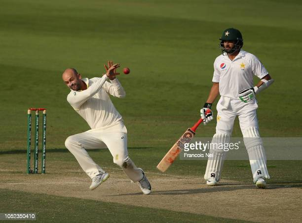 Nathan Lyon of Australia takes a catch from his own bowling to dismiss Fakhar Zaman of Pakistan during day two of the Second Test match between...