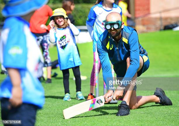 Nathan Lyon of Australia tries batting blind during the WWCB Disability Launch Event at the South Australian Blind Cricket Club on December 2, 2018...