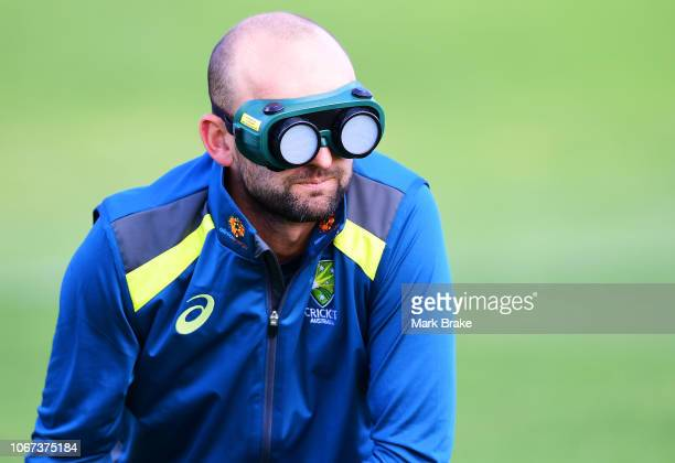 Nathan Lyon of Australia tries bowling blind during the WWCB Disability Launch Event at the South Australian Blind Cricket Club on December 2, 2018...