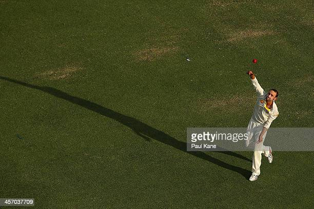 Nathan Lyon of Australia warms up before starting his over during day four of the Third Ashes Test Match between Australia and England at the WACA on...