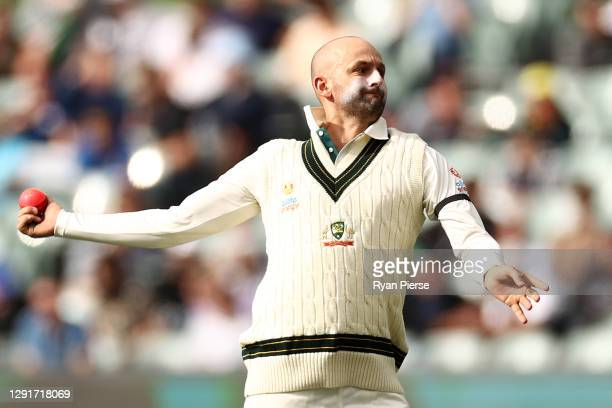 Nathan Lyon of Australia warms up during day one of the First Test match between Australia and India at Adelaide Oval on December 17, 2020 in...