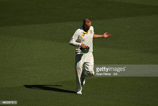Nathan Lyon of Australia waves to the crowd during day five of the First Test match between Australia and India at Adelaide Oval on December 13, 2014...