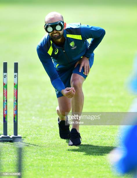 Nathan Lyon of Australia wwhere goggles to simulate blind bowling during the WWCB Disability Launch Event at the South Australian Blind Cricket Club...