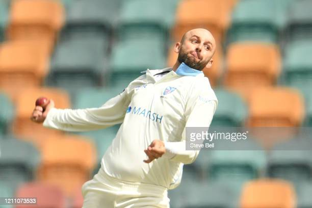 Nathan Lyon of New South Wales bowls a delivery during day three of the Sheffield Shield match between Tasmania and New South Wales at Blundstone...