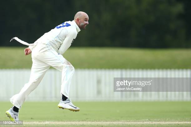 Nathan Lyon of New South Wales bowls during day 3 of the Sheffield Shield match between New South Wales and Queensland at North Dalton Park on April...