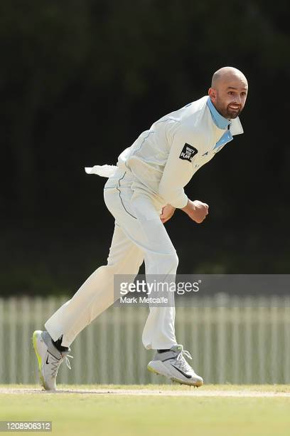 Nathan Lyon of the Blues bowls during day four of the Sheffield Shield match between New South Wales and South Australia at Bankstown Oval on...
