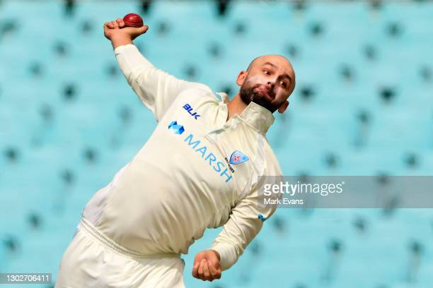 Nathan Lyon of the Blues bowls during day two of the Sheffield Shield match between New South Wales and Victoria at Sydney Cricket Ground on February...