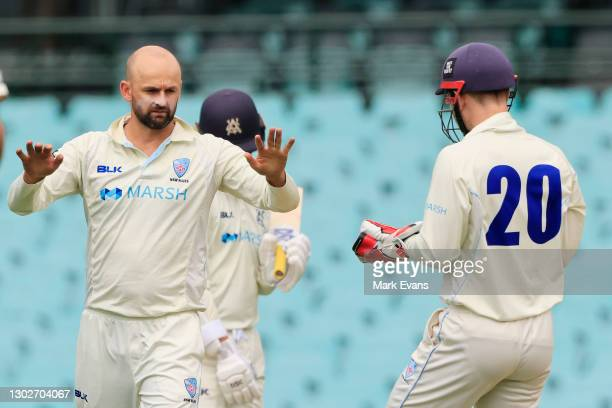 Nathan Lyon of the Blues celebrates the wicket of Marcus Harris of Victoria during day two of the Sheffield Shield match between New South Wales and...