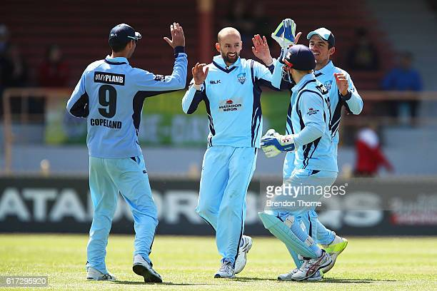 Nathan Lyon of the Blues celebrates with team mates after claiming the wicket of Marnus Labuschagne of the Bulls during the Matador BBQs One Day Cup...
