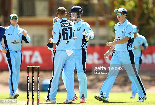 Nathan Lyon of the Blues is congratulated after getting a wicket during the Matador BBQs One Day Cup match between Tasmania and New South Wales at...