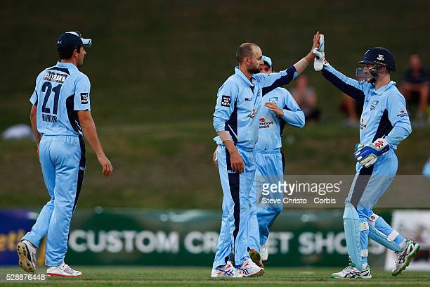 Nathan Lyon of the Blues takes the wicket of Bull's Nathan Reardon caught and bowled during the Matador BBQ's OneDay Cup between New South Wales...