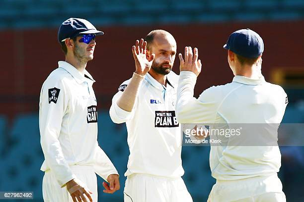 Nathan Lyon of the NSW Blues celebrates with teammates after getting the wicket of Jake Lehmann of the SA Redbacks during day two of the Sheffield...