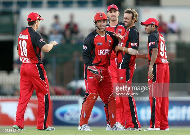 Nathan Lyon of the Redbacks celebrates with team mates after dismissing Daniel Smith during the Twenty20 Big Bash match between the South Australian...