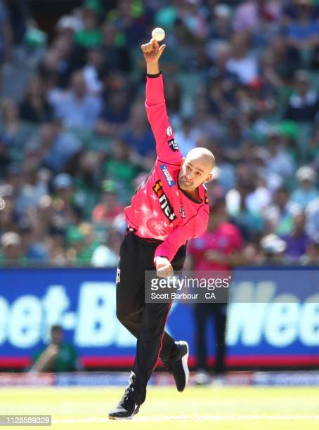 Nathan Lyon of the Sixers bowls during the Big Bash League match between the Melbourne Stars and the Sydney Sixers at Melbourne Cricket Ground on...