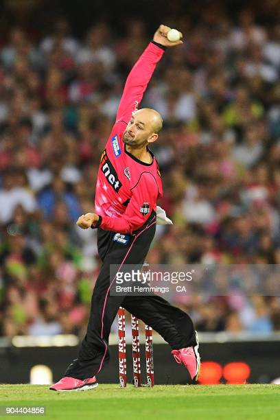 Nathan Lyon of the Sixers bowls during the Big Bash League match between the Sydney Sixers and the Sydney Thunder at Sydney Cricket Ground on January...