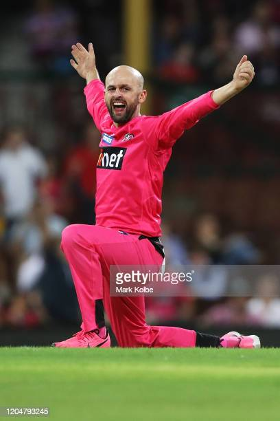Nathan Lyon of the Sixers celebrates taking the wicket of Ben Dunk of the Stars during the Big Bash League Final match between the Sydney Sixers and...