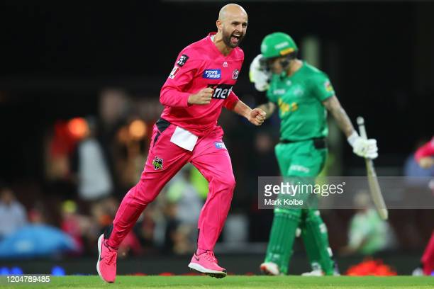 Nathan Lyon of the Sixers celebrates taking the wicket of Marcus Stoinis of the Stars during the Big Bash League Final match between the Sydney...