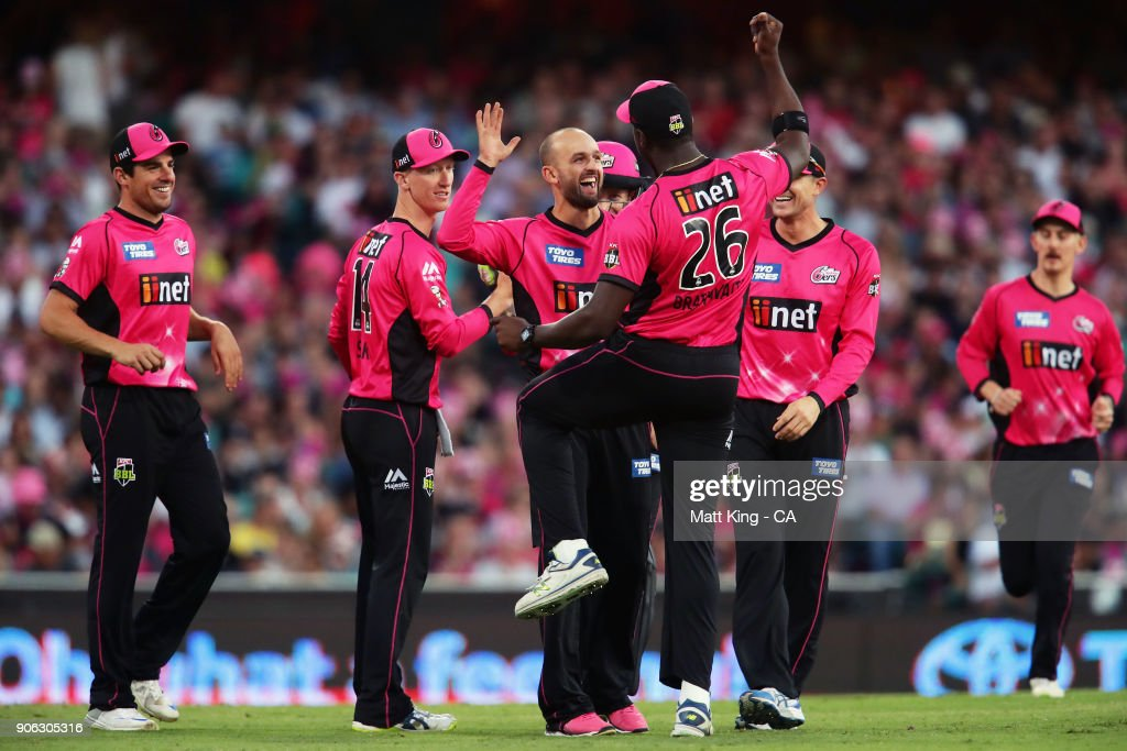 Nathan Lyon of the Sixers celebrates with Carlos Brathwaite of the Sixers after taking the wicket of Sam Heazlett of the Heat during the Big Bash League match between the Sydney Sixers and the Brisbane Heat at Sydney Cricket Ground on January 18, 2018 in Sydney, Australia.