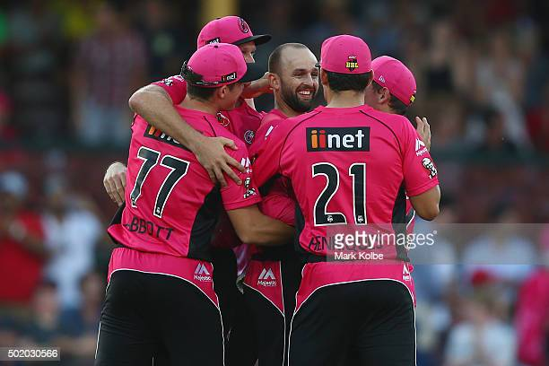 Nathan Lyon of the Sixers celebrates with his team after taking the wicket of Shaun Tait of the Hurricanes to secure victory and a five wicket haul...