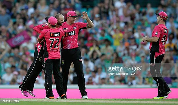 Nathan Lyon of the Sixers celebrates with team mates after taking the wicket of Sam Rainbird of the Hurricanes during the Big Bash League match...