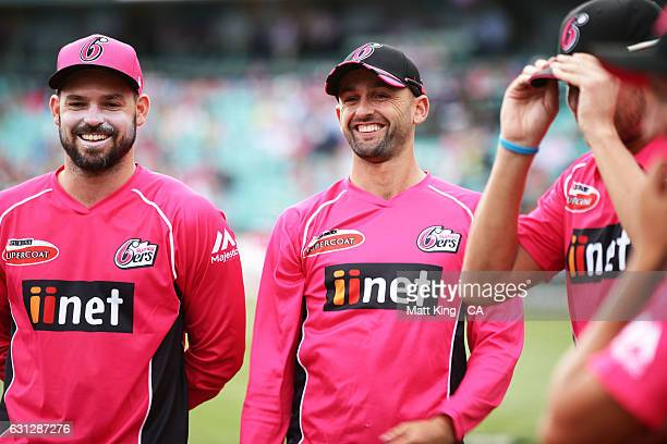 Nathan Lyon of the Sixers looks on before the Big Bash League match between the Sydney Sixers and the Melbourne Renegades at Sydney Cricket Ground on...