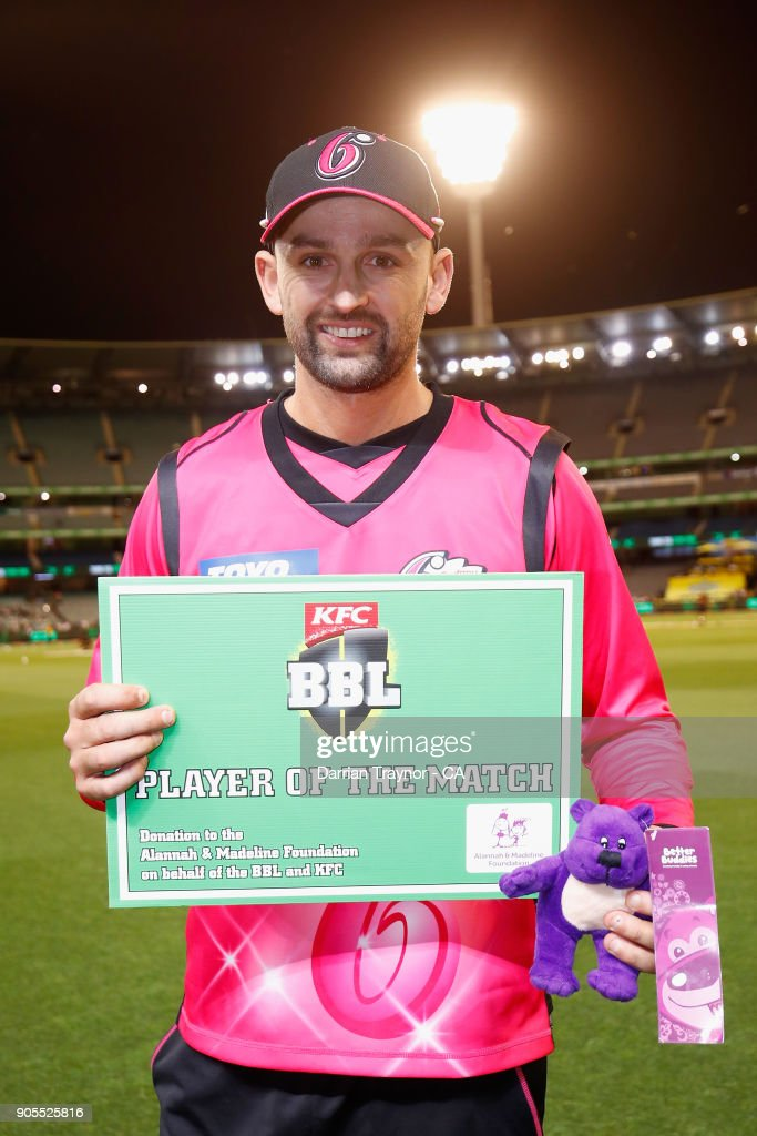 Nathan Lyon of the Sydney Sixers is awared player of the match after the Big Bash League match between the Melbourne Stars and the Sydney Sixers at Melbourne Cricket Ground on January 16, 2018 in Melbourne, Australia.