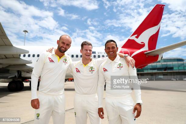 Nathan Lyon Steve Smith and Usman Khawaja pose on the tarmac during an announcement for the Australia Ashes squad at Brisbane Airport on November 17...