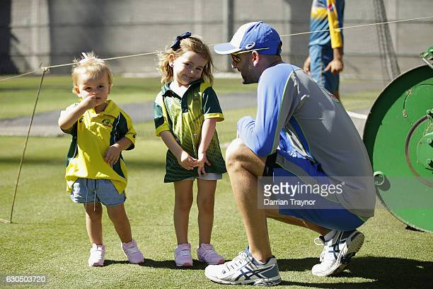 Nathan Lyon takes a break with his children Milla and Harper during an Australian nets session on December 25 2016 in Melbourne Australia