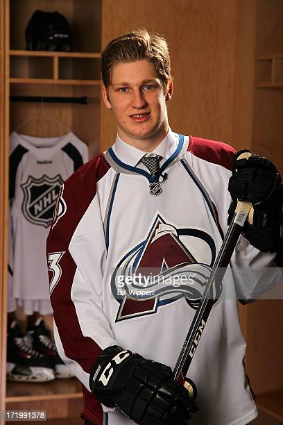 Nathan MacKinnon 1st overall pick by the Colorado Avalanche poses for a portrait during the 2013 NHL Draft at Prudential Center on June 30 2013 in...