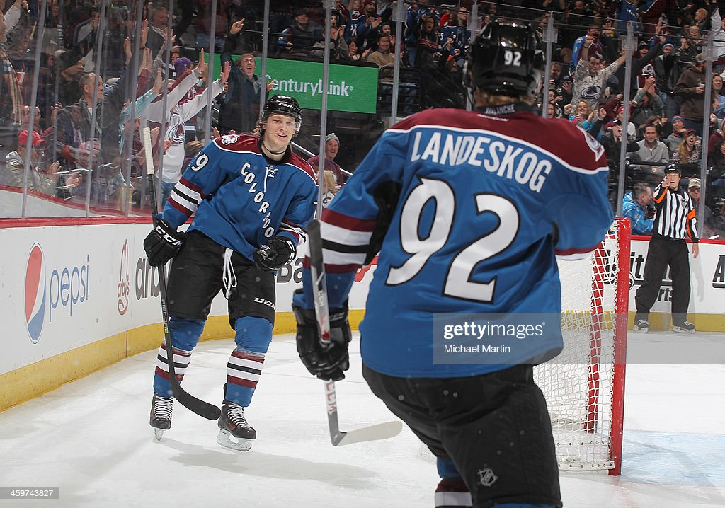 Nathan MacKinnon #29 and Gabriel Landeskog #92 of the Colorado Avalanche celebrate a goal against the Winnipeg Jets at the Pepsi Center on December 29, 2013 in Denver, Colorado. The Jets defeated the Avalanche 2-1 in overtime.Ê