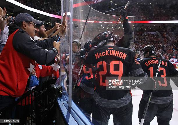 Nathan MacKinnon and Johnny Gaudreau of Team North America celebrate after a third period goal on Team Russia during the World Cup of Hockey 2016 at...