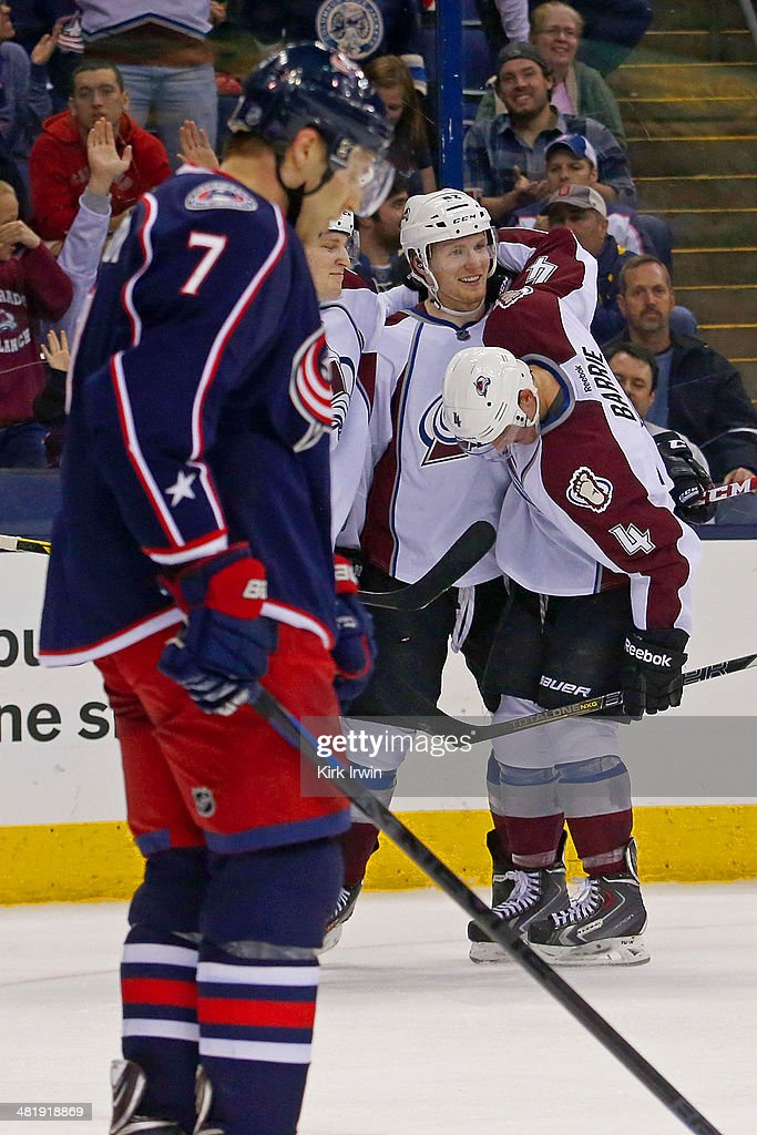 Nathan MacKinnon #29 and Tyson Barrie #4 of the Colorado Avalanche congratulate Gabriel Landeskog #92 on his game-winning goal in the overtime period on April 1, 2014 at Nationwide Arena in Columbus, Ohio. Colorado defeated Columbus 3-2 in overtime.