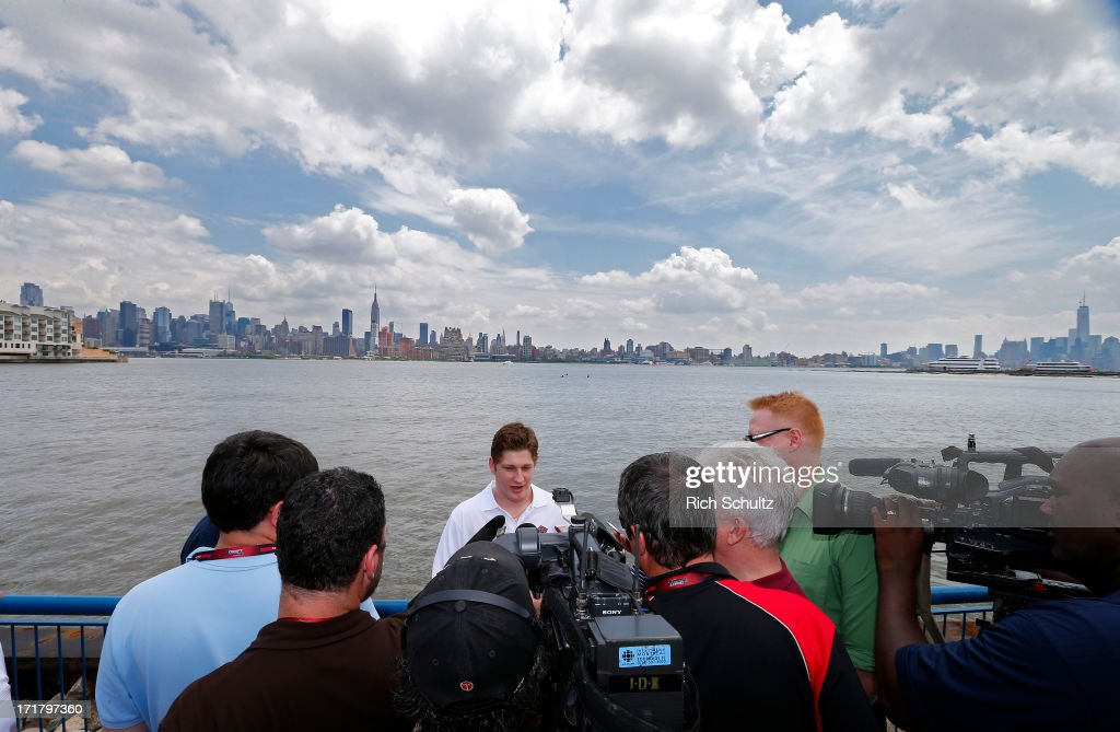 Nathan MacKinnon is surrounded by media during an availability on June 28, 2013 in Weehawken, New Jersey. The NHL will be holding its player draft on June 30 at the Prudential Center in Newark.