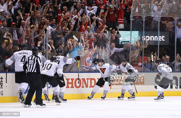 Nathan MacKinnon of Team North America celebrates after scoring an overtime goal against Team Sweden during the World Cup of Hockey 2016 at Air...