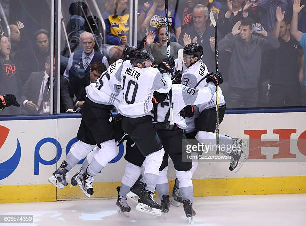 Nathan MacKinnon of Team North America celebrates his gamewinning goal with teammates in overtime against Team Sweden during the World Cup of Hockey...
