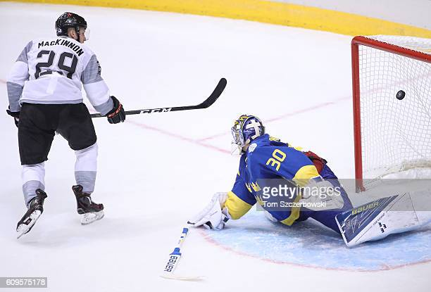 Nathan MacKinnon of Team North America scores the gamewinning goal in overtime past Henrik Lundqvist of Team Sweden during the World Cup of Hockey...