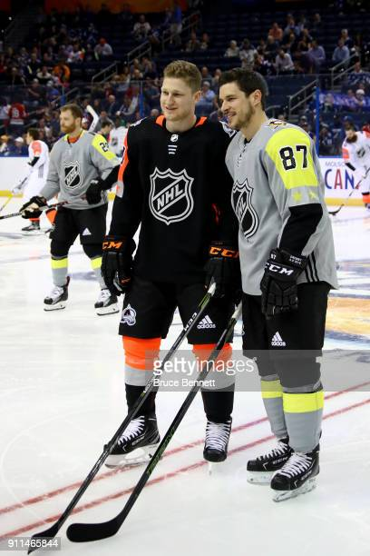 R} Nathan MacKinnon of the Colorado Avalanche and Sidney Crosby of the Pittsburgh Penguins pose for a picture prior to the 2018 Honda NHL AllStar...