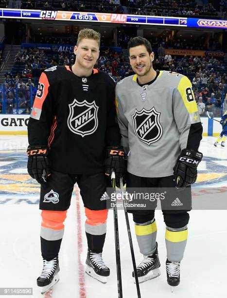 Nathan MacKinnon of the Colorado Avalanche and Sidney Crosby of the Pittsburgh Penguins pose for a photo during warmup prior to the 2018 Honda NHL...