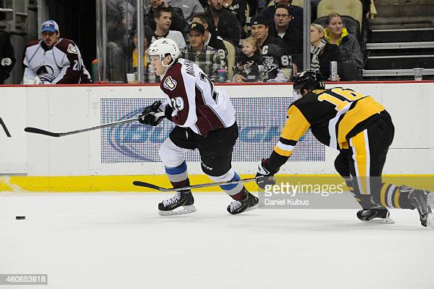 Nathan MacKinnon of the Colorado Avalanche carries the puck past Brandon Sutter of the Pittsburgh Penguins in the third period at Consol Energy...