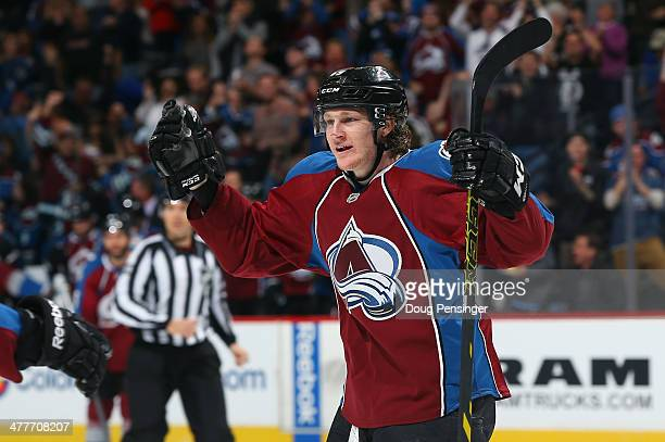 Nathan MacKinnon of the Colorado Avalanche celebrates a secondperiod goal by teammate John Mitchell to take a 10 lead over the Winnipeg Jets at Pepsi...