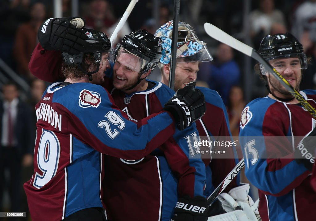 Nathan MacKinnon #29 of the Colorado Avalanche celebrates his game winning overtime goal with Jamie McGinn #11 of the Colorado Avalanche to defeat the Minnesota Wild 4-3 in Game Five of the First Round of the 2014 NHL Stanley Cup Playoffs at Pepsi Center on April 26, 2014 in Denver, Colorado. The Avalanche hold a 3-2 game lead in the series.