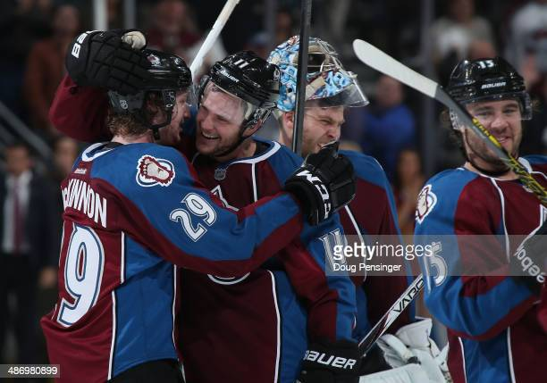 Nathan MacKinnon of the Colorado Avalanche celebrates his game winning overtime goal with Jamie McGinn of the Colorado Avalanche to defeat the...