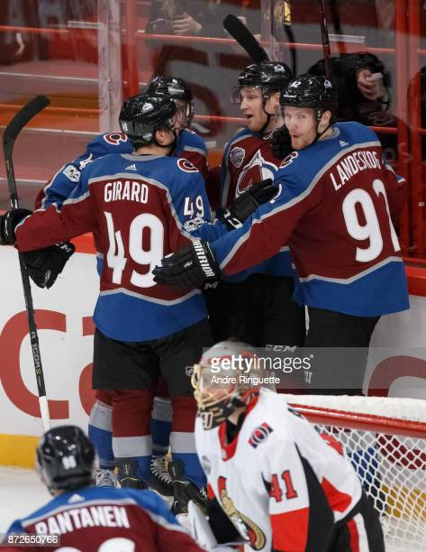 Nathan MacKinnon of the Colorado Avalanche celebrates his third period goal against Craig Anderson of the Ottawa Senators with teammates Samuel...