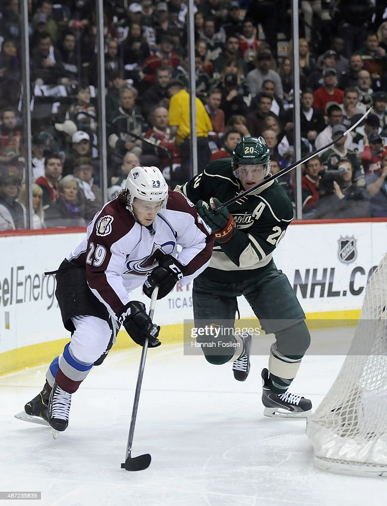 Nathan MacKinnon #29 of the Colorado Avalanche controls the puck against Ryan Suter #20 of the Minnesota Wild during the first period in Game Six of the First Round of the 2014 NHL Stanley Cup Playoffs on April 28, 2014 at Xcel Energy Center in St Paul, Minnesota.