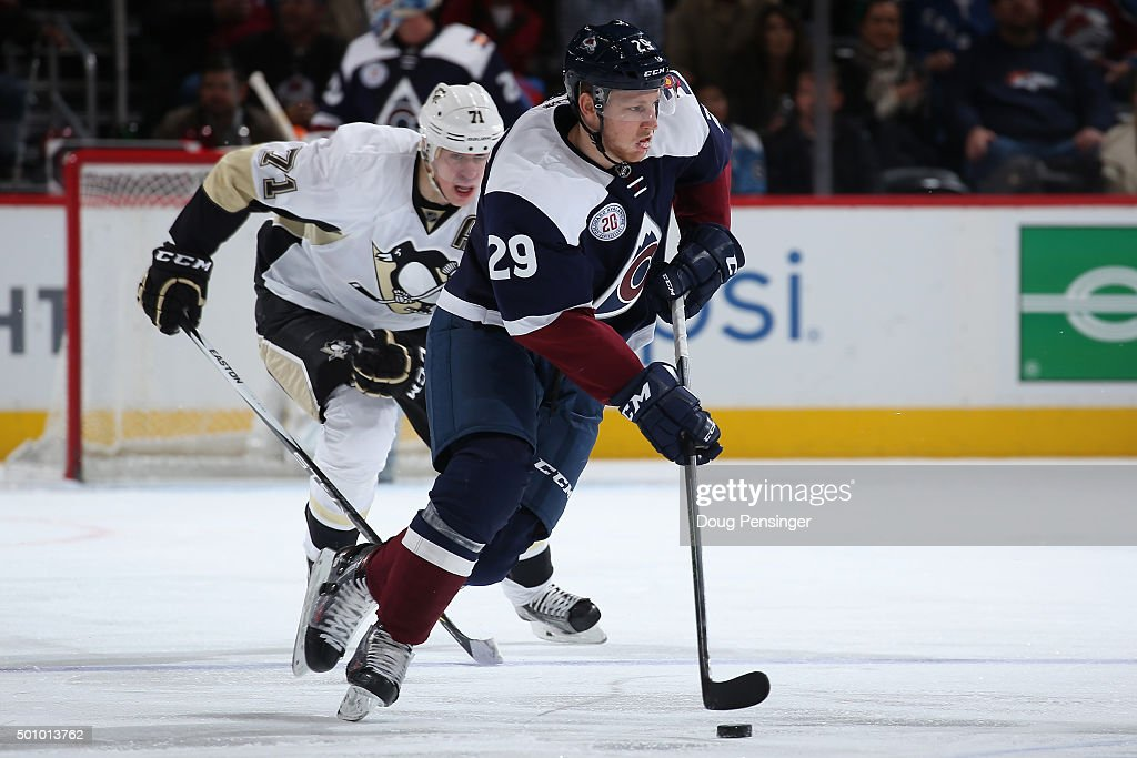 Nathan MacKinnon #29 of the Colorado Avalanche controls the puck against Evgeni Malkin #71 of the Pittsburgh Penguins at Pepsi Center on December 9, 2015 in Denver, Colorado. The Penguins defeated the Avalanche 4-2.
