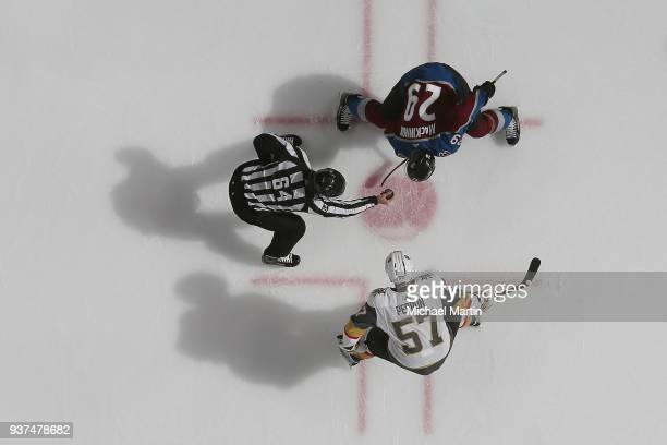 Nathan MacKinnon of the Colorado Avalanche facesoff against David Perron of the Vegas Golden Knights at the Pepsi Center on March 24 2018 in Denver...