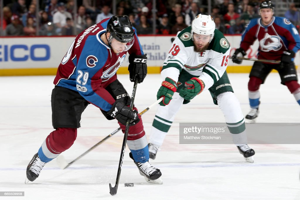 Nathan MacKinnon #29 of the Colorado Avalanche fights for control of the puck against Martin Hanzal #19 of the Minnesota Wild at the Pepsi Center on April 6, 2017 in Denver, Colorado.