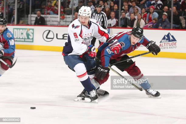 Nathan MacKinnon of the Colorado Avalanche fights for position against Dmitry Orlov of the Washington Capitals at the Pepsi Center on March 29 2017...